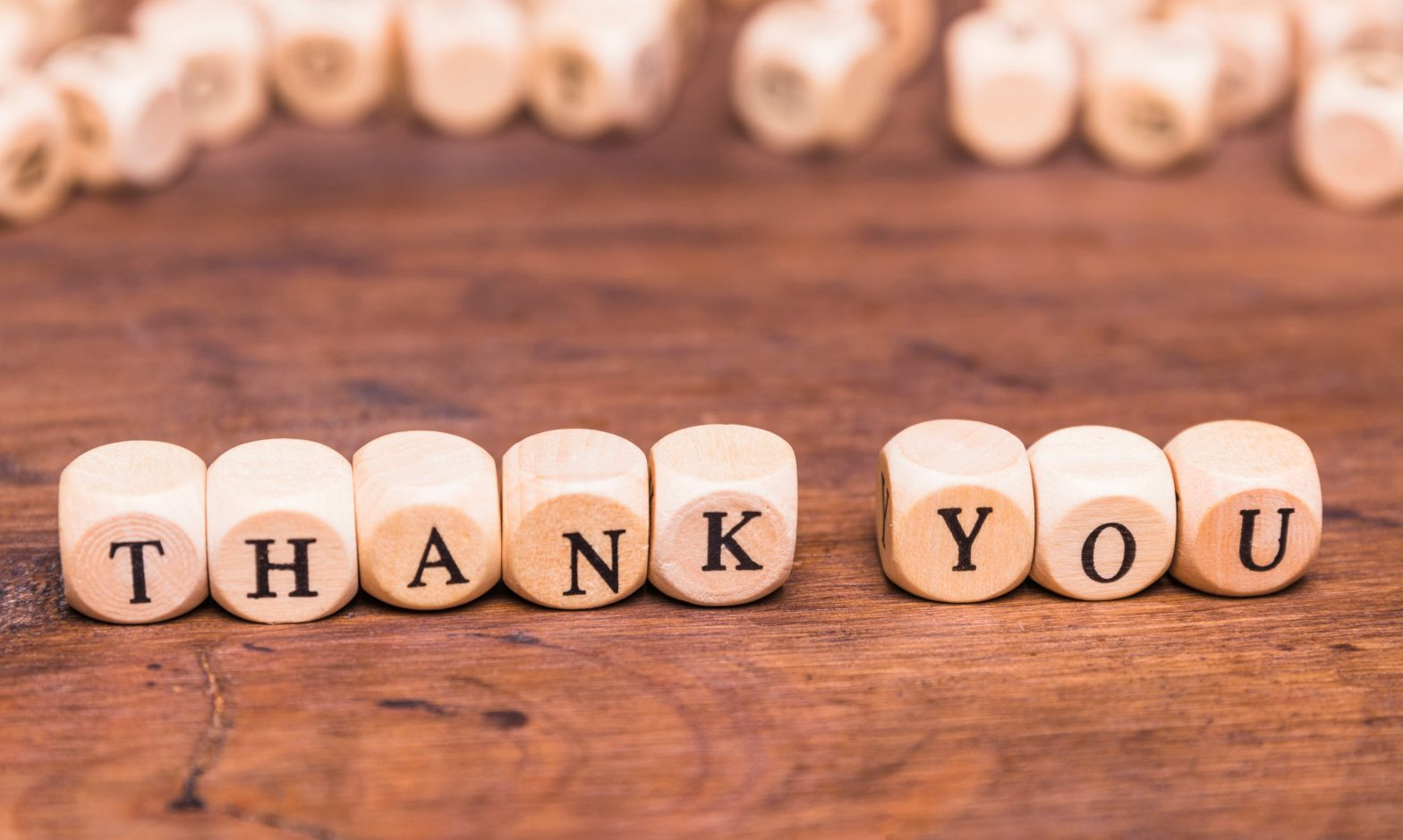 message thank you with wooden cubes Toni García CEO Millennial Inmobiliario