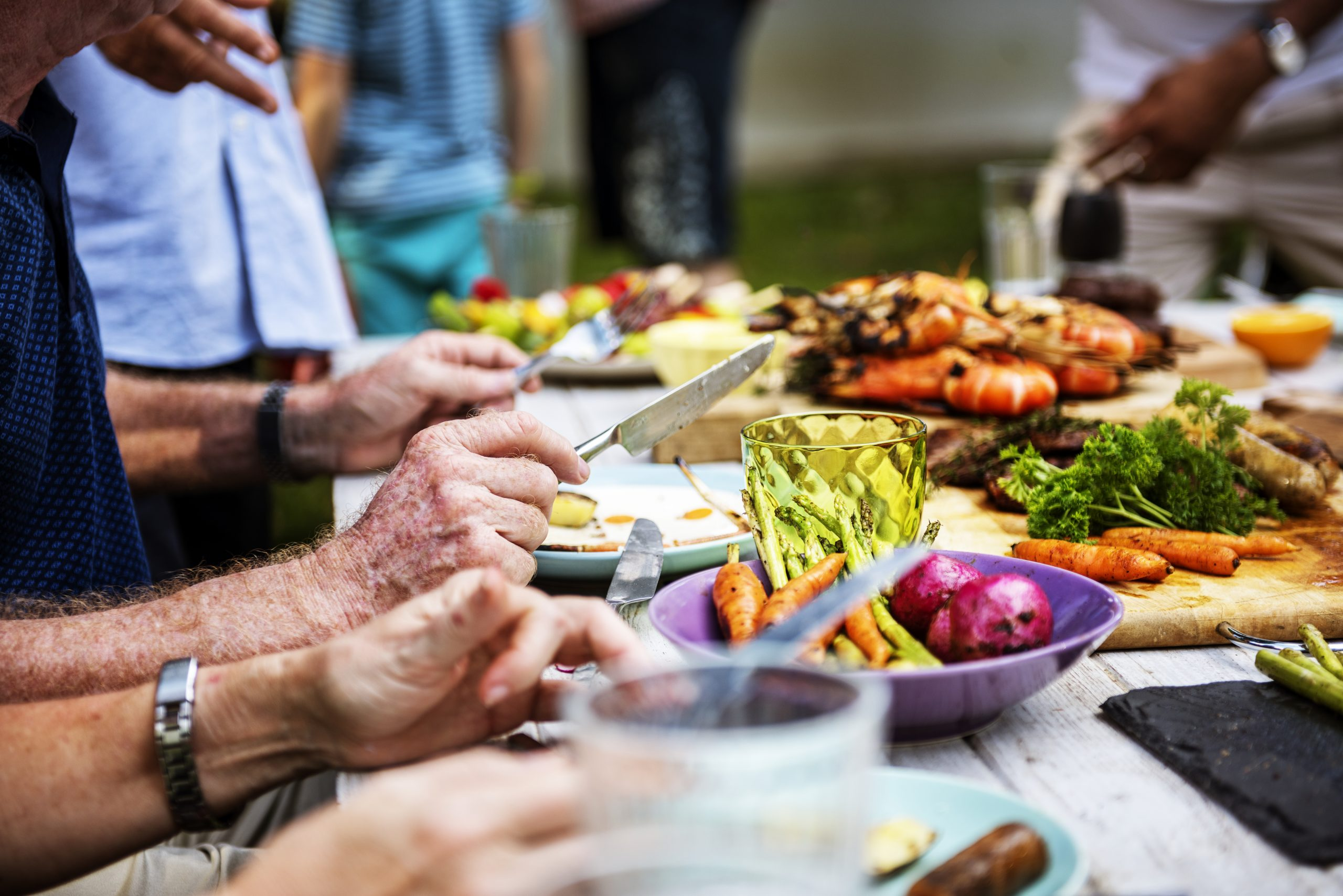 closeup of diverse people enjoying barbecue party together scaled Toni García CEO Millennial Inmobiliario